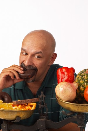 Guy feeling very guilty for his lack of diet discipline photo