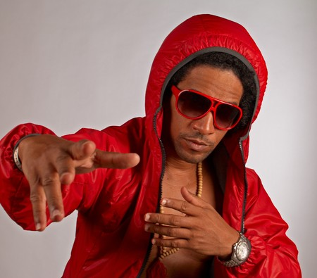 Hip hop artist in shiny red urban outfit photo