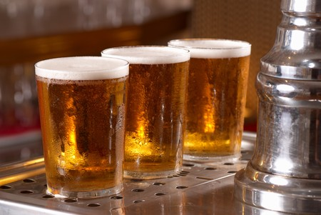 Three freshly filled draught pints ready to be served Stock Photo - 7841114