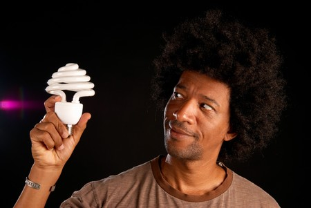 African american guy liking the idea of energy saving photo