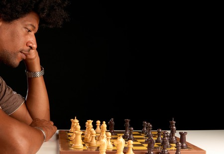 African american man concentrated playing chess photo