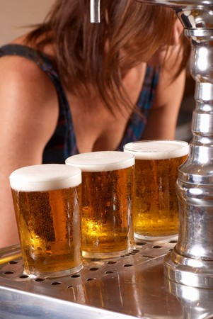 Draft pints ready to be served by the waitress photo