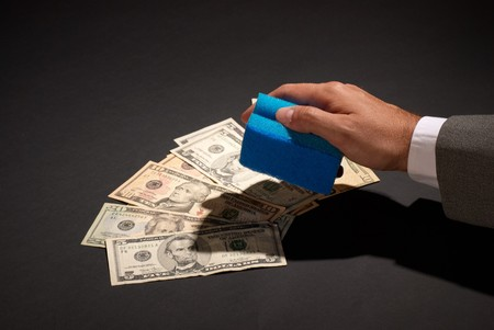 offence: Money laundering with a scourer, financial offence concept Stock Photo