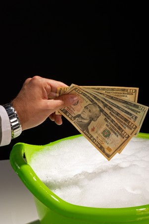 soak: Putting money to soak, money laundering concept