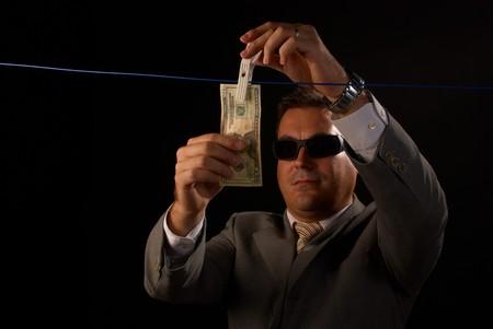 mafioso: Mafia guy doing some serious money laundering Stock Photo