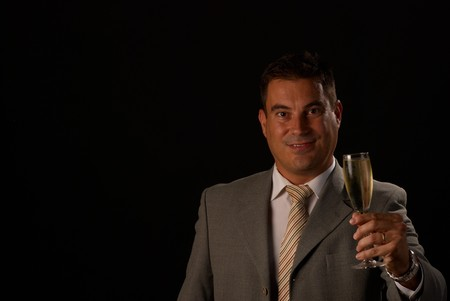Man dressed in suit toasting with a champagne flute Stock Photo - 7937563