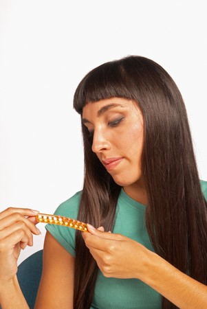 contraceptive: Young woman thinking about  possible contraceptive alternatives