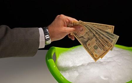 soak: Putting dollar banknotes to soak, money laundering concept