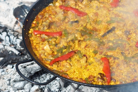 Spanish paella being cooked on an open fire