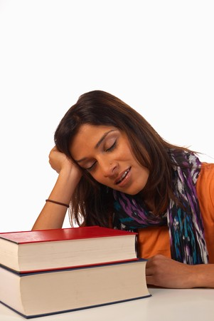 Middle eastern student in an uninterested attitude towards her books Stock Photo - 8170520