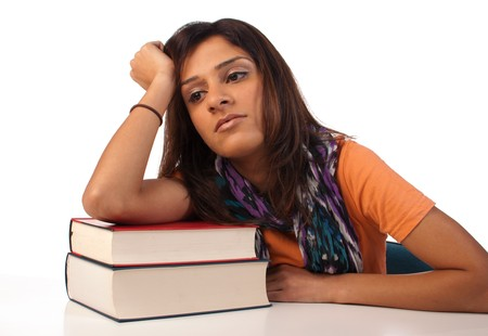 Middle eastern student in an uninterested attitude towards her books Stock Photo - 8170522