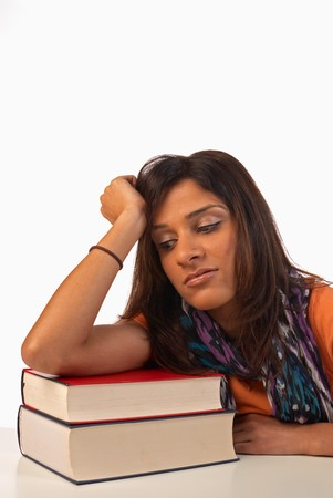 inattentive: Middle eastern student in an uninterested attitude towards her books