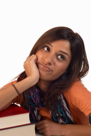 Middle eastern student in an uninterested attitude towards her books Stock Photo - 8170525