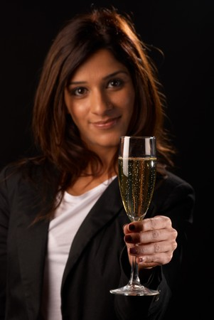 Middle eastern woman toasting with a glass of champagne Stock Photo - 8170530