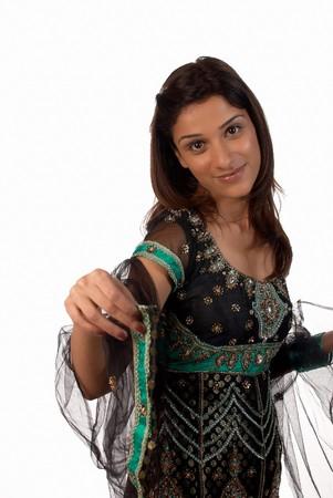 middle eastern woman: Middle eastern woman wearing a traditional sari