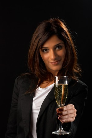 Middle eastern woman toasting with a glass of champagne Stock Photo - 8281956