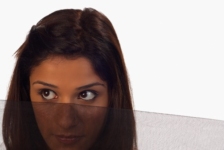 purdah: Middle easter woman, curious look into the world from behind a veil