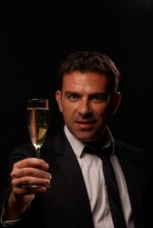 Attractive guy toasting with a glass of champagne Stock Photo - 8288783