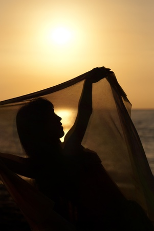 Silhouette take of an oriental dancer  at sunrise photo