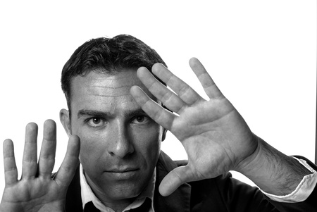 Portrait of a hispanic male in a cool gesture Stock Photo - 8419779