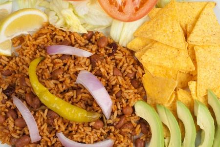 savoury: Savoury spicy rice served with nachos and salad Фото со стока