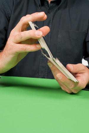 Detail take of a fortuneteller shuffling a deck of tarot cards