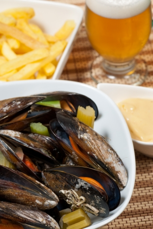 Portion of Belgian style mussels, steamed with vegetables Imagens