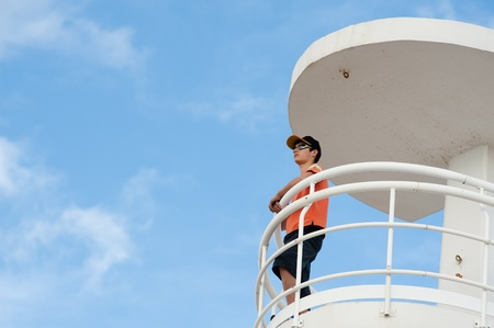 Lifeguard on duty on top of a watch-tower Stock Photo - 8937305