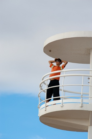 Lifeguard on duty on top of a watch-tower Stock Photo - 9001033