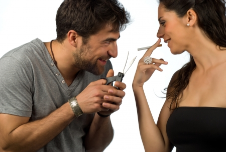Guy trying to help his girlfriend stop smoking Stock Photo - 9195626