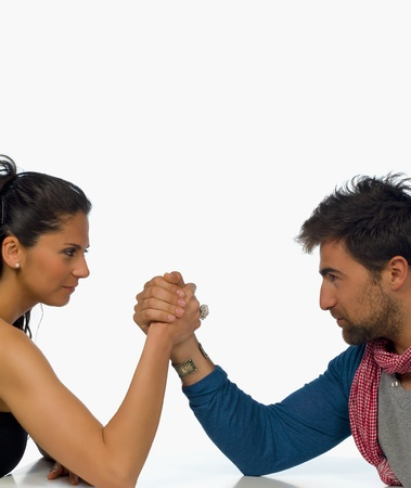 The battle of sexes, arm wrestling couple Stock Photo - 9195620