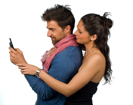 Gril curiously watching over her boyfriends shoulder Stock Photo - 9195625