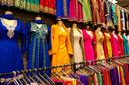 Colorful saris at a street market stall Stock Photo