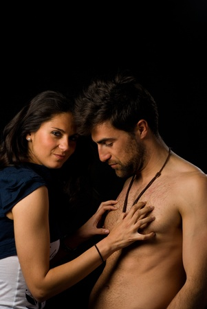 Attractive young lady scratching her guys chest Stock Photo - 9286393