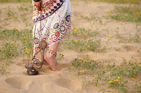 trinkets: Girl walking barefoot on a dune with spring colours