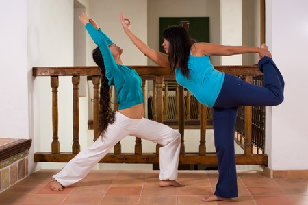 introspective: Mother and daughter enjoying a yoga session indoors