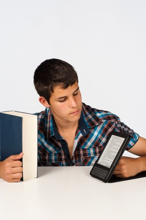 ebook: Teenage student with a conventional and an electronic book