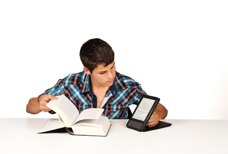 Student comparing a traditional  book with its modern version Stock Photo - 9501678