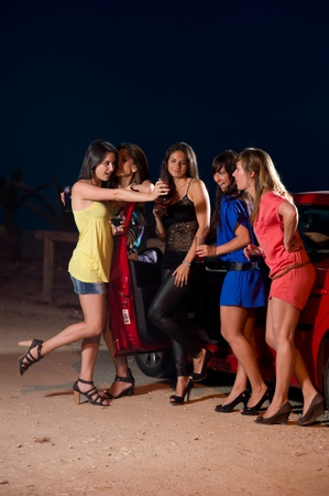 Girls enjoying a warm summer  party night Stock Photo - 9680528