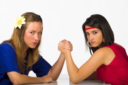 female wrestling: Blond and Hispanic girl competing by arm wrestling