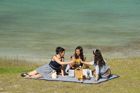 Girls enjoying a pleasant spring time picnic photo