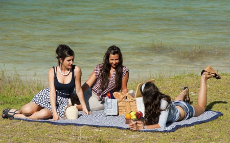 Girls enjoying a pleasant spring time picnic photo