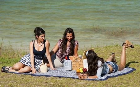 Girls enjoying a pleasant spring time picnic Stock Photo - 9816921