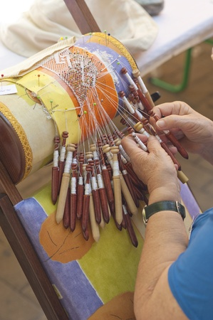 Skilled female hands at the traditional lace making crafts