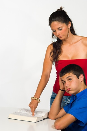 Teenager getting help with his homework, not very happy about it Stock Photo - 9977503