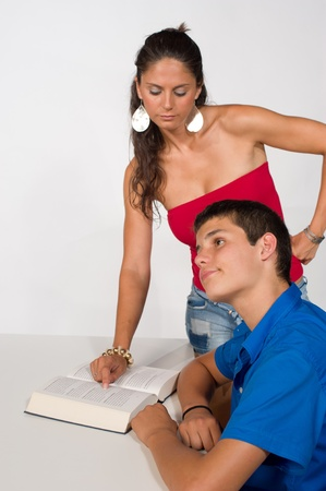 Teenager getting help with his homework, not very happy about it Stock Photo - 9977500