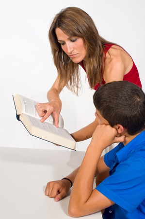 Sudent getting help from a female teacher Stock Photo - 9977749