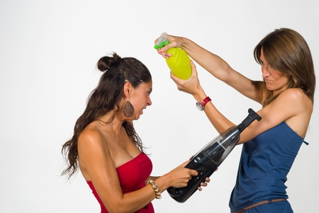fooling: Girls fooling around with  some household equipment Stock Photo