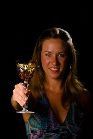 Woman toasting with classy crystal glass, copy space available Stock Photo - 9977183