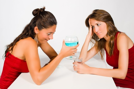Drunk girl boring her friend with her mumbling Stock Photo - 9976749